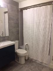 Modern Bathroom with Bath/Shower - Level 2 (2 doors)