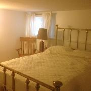 brass bed in bedroom